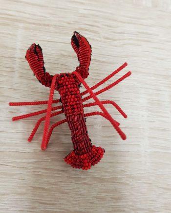 Broche artisanale représentant un Homard rouge, brodée à la main