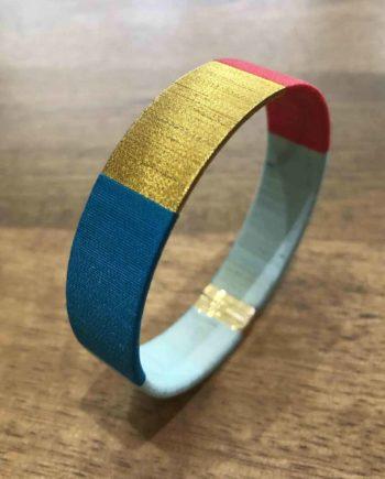 bracelet tissé main bleu rouge et or