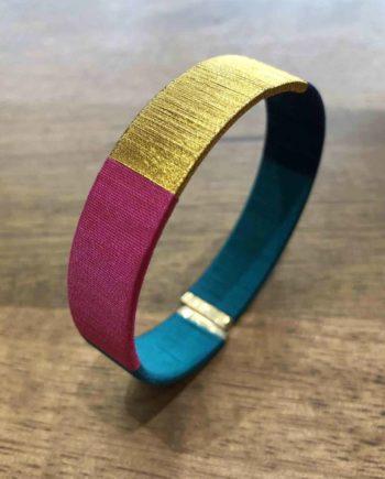 bracelet tissé main bleu, fushia et or