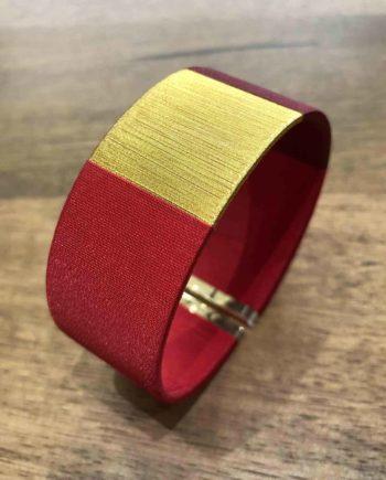 manchette tissée main rouge et or