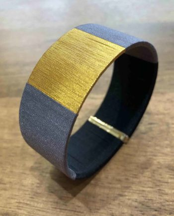 manchette tissée main gris et or