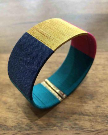 manchette tissée main bleu, fushia et or