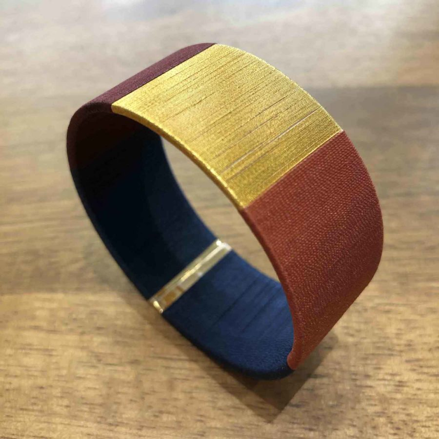 Manchette tissée à la main bleu, marron et or