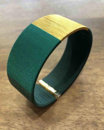 Manchette tissée à la main vert et or